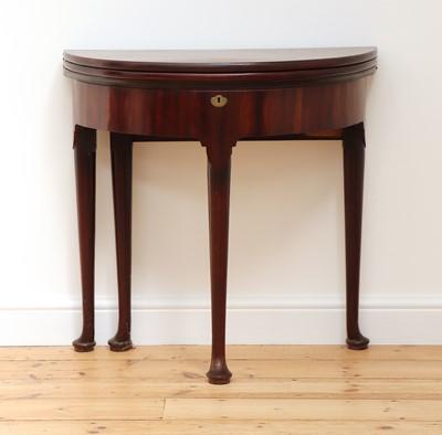 Lot 33 - A George II mahogany triple fold-over demilune side table
