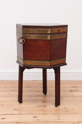 Lot 59 - A George III mahogany brass-bound wine cooler and stand