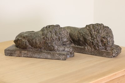 Lot 30 - A pair of cast lead lions after Antonio Canova