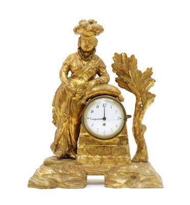 Lot 69 - An 18th century carved pine and gilt figural mantel clock