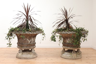 Lot 95 - A pair of large composite stone garden planters