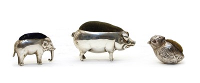 Lot 13 - A novelty silver pin cushion in the form of a pig