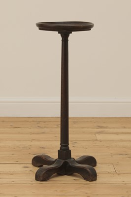 Lot 383 - An oak candle stand