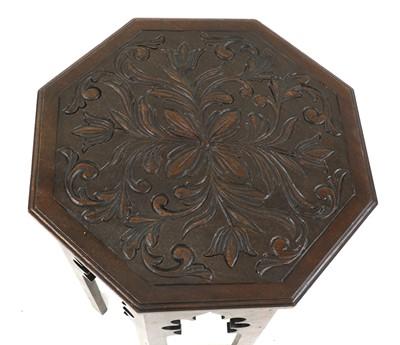 Lot 76 - An octagonal mahogany lamp table