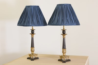 Lot 94 - A pair of French Empire-style patinated and gilt-bronze candlestick lamps