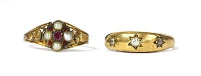 Lot 9 - A gold three stone diamond ring
