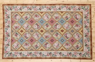 Lot 392 - A needlepoint rug