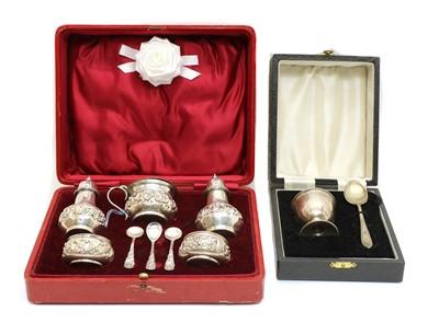 Lot 24 - An Edwardian cased silver cruet set