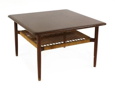 Lot 577 - A teak coffee table