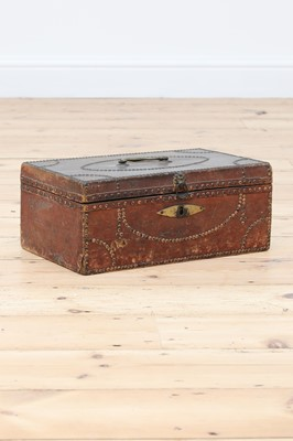 Lot 65 - A red leather and studded deeds box