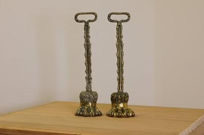 Lot 419 - A pair of cast brass door porters