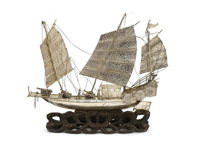 Lot 3 - A Chinese export white metal model of a junk