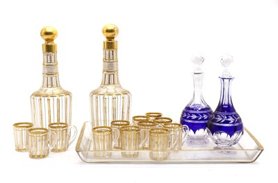 Lot 77 - A cut glass and gilt liqueur set