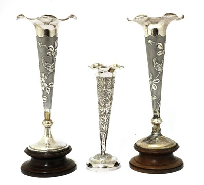 Lot 144 - A pair of Chinese export silver repoussé vases