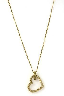 Lot 67 - An 18ct gold diamond heart pendant