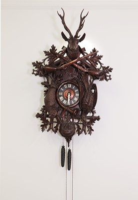 Lot 398 - A large carved Black Forest wall-hanging cuckoo clock