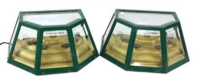 Lot 552 - A pair of green wall lights