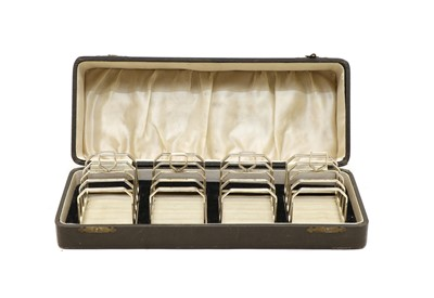 Lot 36A - A cased set of four Art Deco silver four division toast racks