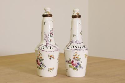 Lot 429 - A pair of English enamel condiment bottles
