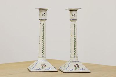 Lot 432 - A pair of enamel candlesticks