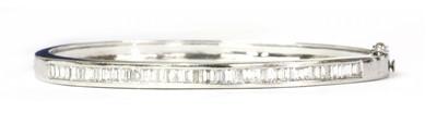 Lot 79 - A white gold diamond hinged bangle