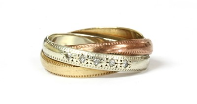 Lot 33 - A 9ct three colour gold diamond set three band ring