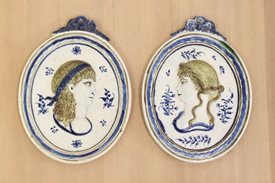 Lot 440 - A pair of oval moulded pottery plaques