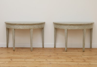 Lot 491 - A pair of Swedish Gustavian-style painted demilune side tables