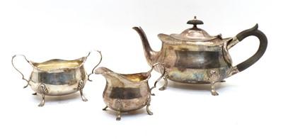 Lot 1 - An Edwardian silver three-piece tea service