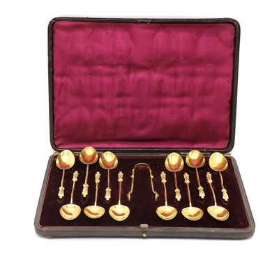 Lot 41 - A set of Victorian silver gilt apostle teaspoons and sugar tongs