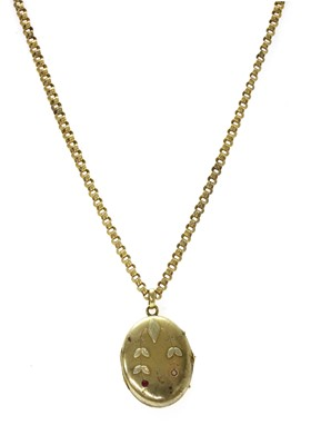 Lot 16 - A Russian gold ruby set locket and chain