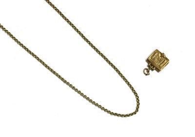 Lot 108 - A 9ct gold articulated Bible charm