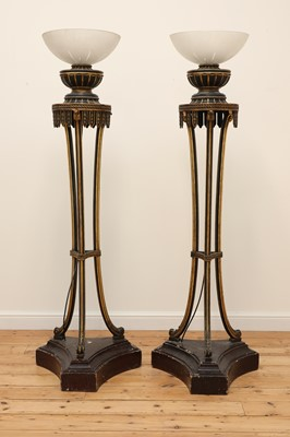 Lot 45 - A pair of carved and painted torchères