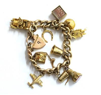 Lot 59 - A gold charm bracelet