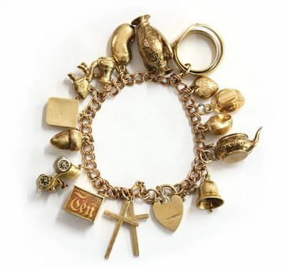Lot 61 - A gold charm bracelet