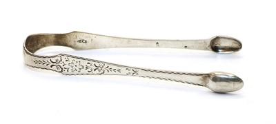 Lot 17 - A pair of Irish provincial silver sugar tongs
