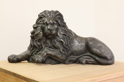 Lot 29 - A large cast iron recumbent lion