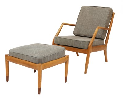 Lot 588 - A Danish birch and teak lounger and stool