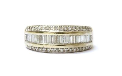 Lot 78 - An 18ct white gold three row diamond set half hoop ring