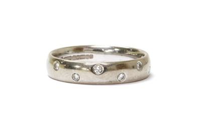 Lot 74 - An 18ct white gold diamond set wedding ring