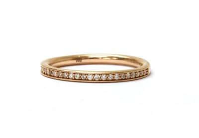 Lot 59 - A 14ct rose gold diamond half eternity ring