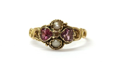Lot 3 - A Victorian 15ct gold garnet and split pearl ring