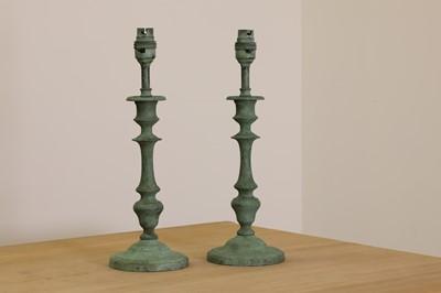 Lot 405 - A pair of verdigris candlestick lamps
