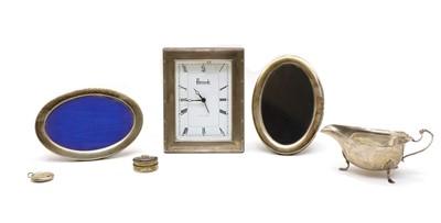 Lot 24 - A silver cased Harrods boudoir clock