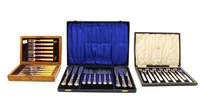 Lot 23 - A cased set of twelve Continental silver hors d'ourves forks