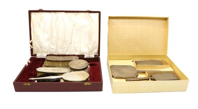 Lot 22 - A cased silver dressing table set