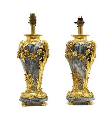 Lot 96 - A pair of grey marble and ormolu table lamps of vase form