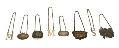 Lot 59 - Three silver decanter labels