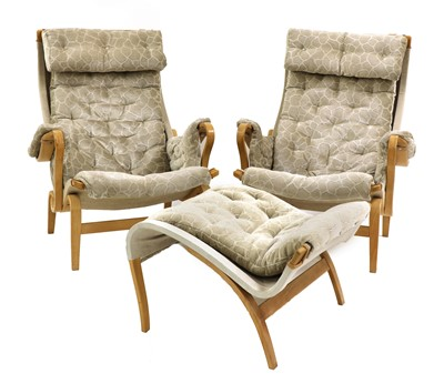Lot 575 - A pair of 'Pernilla 69' lounge chairs and an ottoman