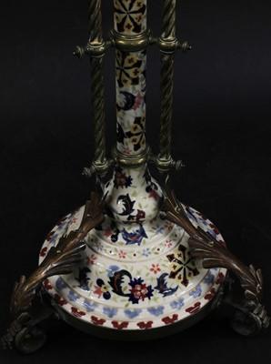Lot 26 - A Hungarian porcelain and brass adjustable standard lamp